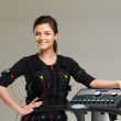 Young womin training costume near Electro Muscular Stimulation EMS machine  — Stock Photo #41872717