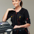 Young womin training costume near Electro Muscular Stimulation EMS machine  — Stock Photo #41872719