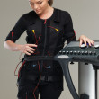 Young womin training costume near Electro Muscular Stimulation EMS machine  — Stock Photo #41872721