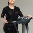 Young womin training costume near Electro Muscular Stimulation EMS machine  — Stock Photo #41872733