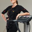 Young womin training costume near Electro Muscular Stimulation EMS machine  — Stock Photo #41872735