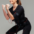 Young womdoing exercise  in Electro Muscular Stimulation EMS training costume  — Stock Photo #41872737