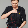 Young womputting on  Electro Muscular Stimulation EMS exercise training costume  — Stock Photo #41872777