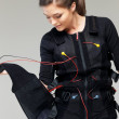 Young womputting on  Electro Muscular Stimulation EMS exercise training costume  — Stock Photo #41872779
