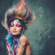 Young woman muse with creative body art and hairdo — Stock Photo #42240305