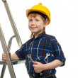Little boy in protective helmet with wrench tool on a ladder — Stock Photo #42240747