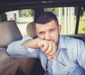 Handsome man in a car interior  — Stock Photo