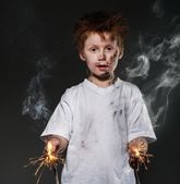 Little redhead bad boy with sparkling wires — Stock Photo