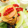 Healthy breakfast with pancakes, fresh berries and milk on tablecloth — Stock Photo