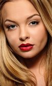 Beautiful young woman with seductive red lips — Stock Photo