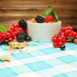 Bowl with muesli and fresh berries on tablecloth — Stock Photo