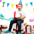 Little happy boy holding gift box — Stock Photo