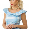 Sexy blond pin up style young woman in blue dress — Stock fotografie