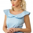 Sexy blond pin up style young woman in blue dress — Stok fotoğraf