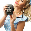 Blond coquette pin up style young woman in blue dress with vintage camera — Stock Photo #43198735
