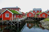 Traditional wooden houses on a water in norwegian village — Stock Photo