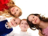 Croup of happy children standing in a circle — Stock Photo