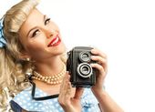 Blond coquette pin up style young woman in blue dress with vintage camera — Stock Photo