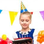 Little happy girl holding gift box — Stock Photo #43666495
