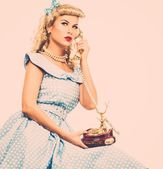 Coquette blond pin up style young woman in blue dress with vintage phone  — Stock Photo