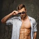 Stylish man in blue shirt wearing sunglasses  — Stock Photo #44118247
