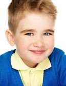 Sly little boy in blue cardigan and yellow shirt  — Stock Photo