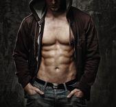 Stylish man with muscular torso wearing hoodie — Stock Photo