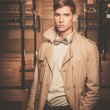 Handsome young man in coat inside vintage train coach — Stock Photo