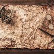 Sextant and logbook on a vintage map — Stock Photo