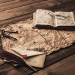 Bunch of old keys, book and envelope on a vintage map — Stockfoto