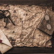 Bunch of old keys, book and envelope on a vintage map — ストック写真