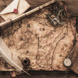Nautical objects on a vintage map — Stock Photo