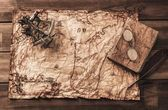 Sextant and logbook on a vintage map  — ストック写真