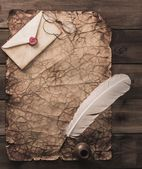 Writing accessories on a vintage paper on wooden background  — Stockfoto