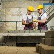 Worker and foreman in a safety hats performing quality check on a factory — Stock Photo #45010831