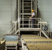 Man in a safety hat performing check on a factory   — Stock Photo