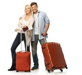 Happy couple with suitcases and map — Stock Photo