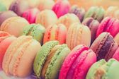Colourful tasty macaroons in a row — Stock fotografie