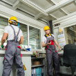 Two operators  in factory control room — Stock Photo #45400939