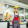 Worker in factory control room — Stock Photo