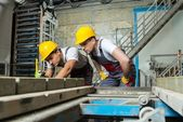 Worker and foreman in a safety hats — Stock Photo