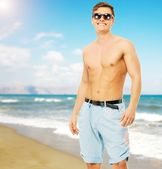Man on a beach — Stock Photo