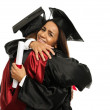 Happy graduated young multi ethnic students couple hugging — Stock Photo