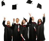 Happy multi ethnic group of graduated young students throwing hats isolated on white — Foto de Stock