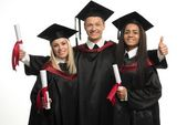 Multi ethnic group of graduated young students isolated on white — Stock Photo
