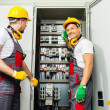 Two electricians in a safety hat and headphones on a factory — Stock Photo #46193321