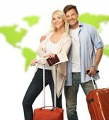 Happy couple with suitcases and documents against world map — Stock Photo