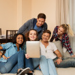 Group of young multi ethnic friends taking selfie in home interior — Foto de Stock