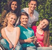 Multi ethnic group of teenage friends in a park  — Stock Photo
