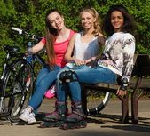 Multi ethnic group of sporty teenage girls in a park — Stock Photo